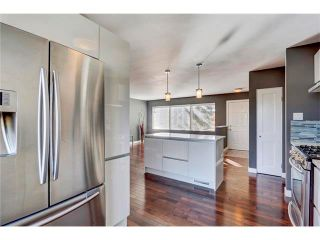 Photo 5: 5612 LADBROOKE Drive SW in Calgary: Lakeview House for sale : MLS®# C4036600