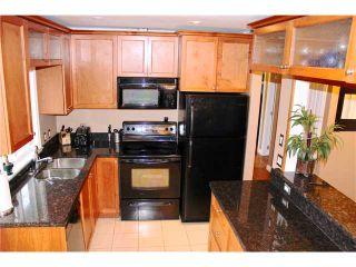 Photo 3: 1491 COMO LAKE AV in Coquitlam: Harbour Place House for sale : MLS®# V979371