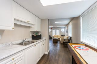 """Photo 34: 107 5909 177B Street in Surrey: Cloverdale BC Condo for sale in """"Carridge Court"""" (Cloverdale)  : MLS®# R2602969"""