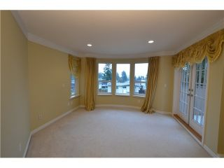 """Photo 15: 2201 HAVERSLEY Avenue in Coquitlam: Central Coquitlam House for sale in """"MUNDY PARK"""" : MLS®# R2141892"""