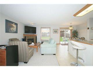 Photo 5: 150 TUSCARORA Way NW in Calgary: Tuscany House for sale : MLS®# C4065410