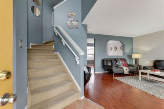 Photo 4: 335 Arbour Grove Close NW in Calgary: Arbour Lake Detached for sale : MLS®# A1137641