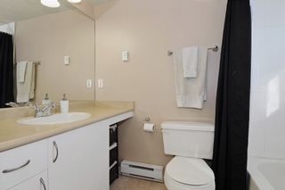 """Photo 13: 301 5465 203RD Street in Langley: Langley City Condo for sale in """"STATION 54"""" : MLS®# F1436316"""