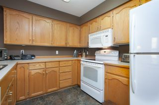 "Photo 11: 312 11595 FRASER Street in Maple Ridge: East Central Condo for sale in ""BRICKWOOD PLACE"" : MLS®# R2050704"