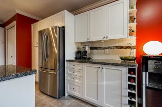 """Photo 13: 10 7250 122 Street in Surrey: East Newton Townhouse for sale in """"STRAWBERRY HILL"""" : MLS®# R2622818"""