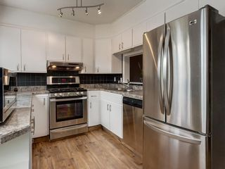 Photo 12: 7 10401 19 Street SW in Calgary: Braeside Row/Townhouse for sale : MLS®# A1106437