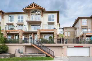 Photo 1: 9 140 Rockyledge View NW in Calgary: Rocky Ridge Row/Townhouse for sale : MLS®# A1118889