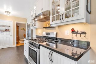 Photo 15: 1565 HARBOUR Drive in Coquitlam: Harbour Chines House for sale : MLS®# R2613539