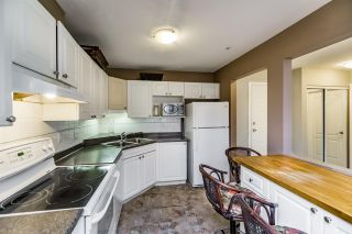 "Photo 3: 406 9626 148 Street in Surrey: Guildford Condo for sale in ""Hartford Woods"" (North Surrey)  : MLS®# R2106044"