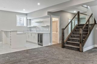 Photo 39: 211 Kinniburgh Place: Chestermere Detached for sale : MLS®# A1078763