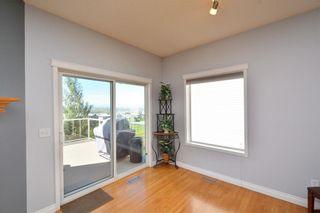 Photo 17: 303 GLENEAGLES View: Cochrane House for sale : MLS®# C4130061