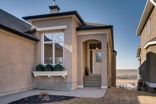 Photo 2: 244 Springbluff Heights SW in Calgary: Springbank Hill Detached for sale : MLS®# A1094759