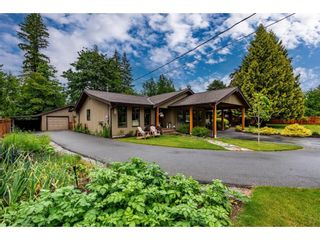 Photo 1: 24107 52A Avenue in Langley: Salmon River House for sale : MLS®# R2593609