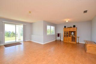Photo 40: 303 GLENEAGLES View: Cochrane House for sale : MLS®# C4130061
