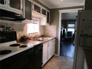 """Photo 5: 8819 75TH Street in Fort St. John: Fort St. John - City SE Manufactured Home for sale in """"ANNEOFIELD"""" (Fort St. John (Zone 60))  : MLS®# N230729"""