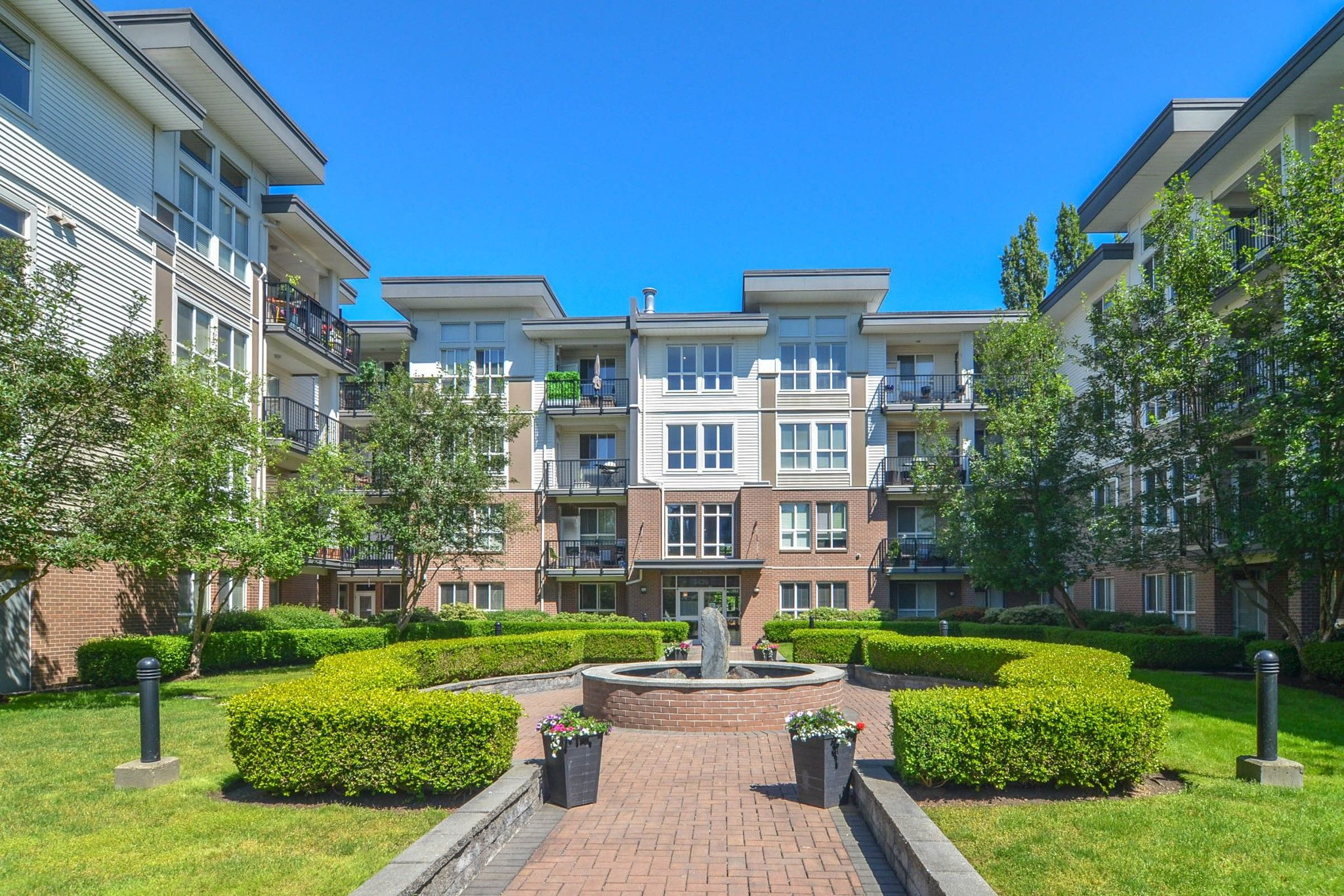"""Main Photo: 418 5430 201 Street in Langley: Langley City Condo for sale in """"The Sonnet"""" : MLS®# R2588283"""