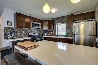 Photo 11: 2421 36 Street SE in Calgary: Southview Detached for sale : MLS®# A1072884