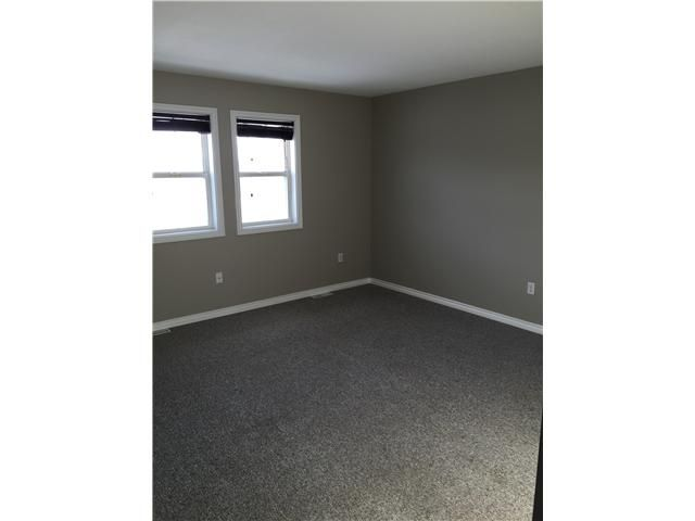 Photo 4: Photos: 10204 103RD Avenue in Fort St. John: Fort St. John - City NW 1/2 Duplex for sale (Fort St. John (Zone 60))  : MLS®# N241739