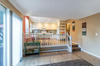 Photo 4: 143 Silver Brook Road NW in Calgary: Silver Springs Detached for sale : MLS®# A1141284