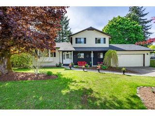 """Photo 2: 5693 246B Street in Langley: Salmon River House for sale in """"Strawberry Hills"""" : MLS®# R2581295"""