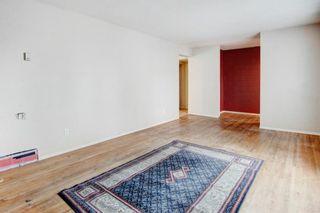 Photo 5: 411 Goddard Avenue NE in Calgary: Greenview Row/Townhouse for sale : MLS®# A1119433