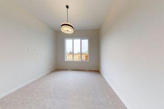 Photo 25: 16 Cranbrook Mews SE in Calgary: Cranston Semi Detached for sale : MLS®# A1020393