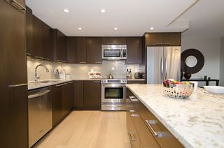 """Photo 12: 313 1490 PENNYFARTHING Drive in Vancouver: False Creek Condo for sale in """"HARBOUR COVE"""" (Vancouver West)  : MLS®# V938539"""