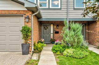 Main Photo: 2 64 Woodacres Crescent SW in Calgary: Woodbine Row/Townhouse for sale : MLS®# A1131075