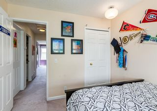 Photo 26: 19 Coachway Green SW in Calgary: Coach Hill Row/Townhouse for sale : MLS®# A1144999
