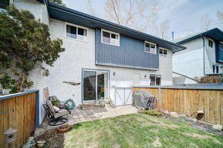 Photo 40: 32 800 Bowcroft Place: Cochrane Row/Townhouse for sale : MLS®# A1106385