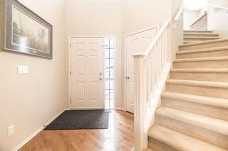 Photo 2: 403 CIMARRON Boulevard: Okotoks House for sale : MLS®# C4170215