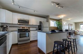 Photo 10: 75 SUMMERWOOD Road SE: Airdrie House for sale : MLS®# C4174518