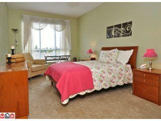 "Photo 8: 419 13880 70TH Avenue in Surrey: East Newton Condo for sale in ""Chelsea Gardens"" : MLS®# F1125041"