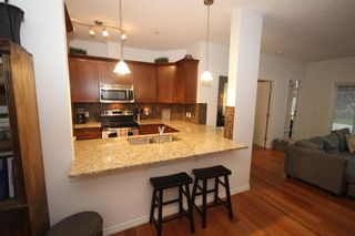 Photo 8: 2101 4 Kingsland Close SE: Airdrie Apartment for sale : MLS®# A1117201