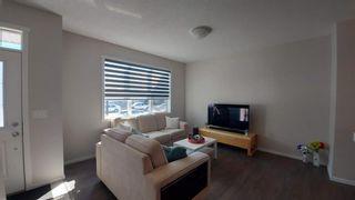Photo 5: 110 Auburn Meadows Avenue SE in Calgary: Auburn Bay Semi Detached for sale : MLS®# A1095114