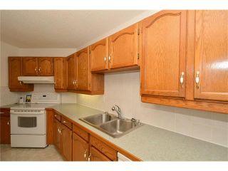 Photo 15: 12 WEST COPITHORNE Place: Cochrane House for sale : MLS®# C4049219