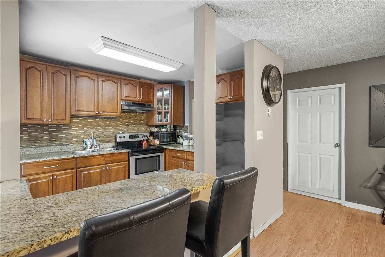 """Main Photo: 102 9138 CAPELLA Drive in Burnaby: Simon Fraser Hills Townhouse for sale in """"Mountain Wood"""" (Burnaby North)  : MLS®# R2541472"""