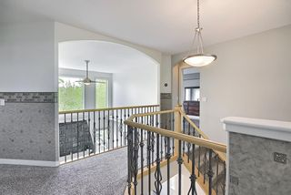 Photo 31: 12 Strathlea Place SW in Calgary: Strathcona Park Detached for sale : MLS®# A1114474
