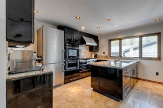 Photo 4: 343 Parkwood Close SE in Calgary: Parkland Detached for sale : MLS®# A1140057