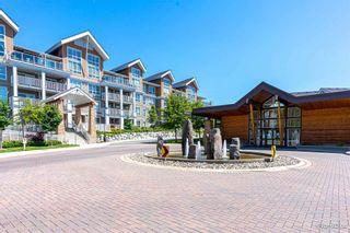 "Photo 1: 101 6490 194 Street in Surrey: Clayton Condo for sale in ""Waterstone"" (Cloverdale)  : MLS®# R2601636"