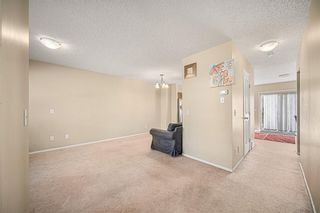 Photo 8: 38 Eversyde Common SW in Calgary: Evergreen Row/Townhouse for sale : MLS®# A1144628