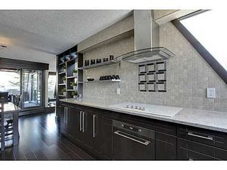 Photo 9: 19 828 COACH BLUFF Crescent SW in Calgary: 2 and Half Storey for sale : MLS®# C3563691