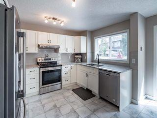 Photo 7: 161 Douglasbank Way SE in Calgary: Douglasdale/Glen Detached for sale : MLS®# A1141406