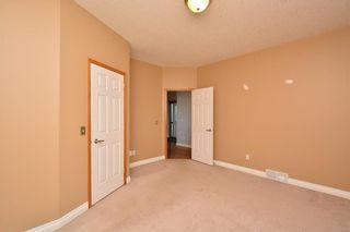 Photo 31: 303 GLENEAGLES View: Cochrane House for sale : MLS®# C4130061
