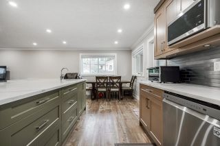 """Photo 12: 5059 199A Street in Surrey: Langley City House for sale in """"Nicomekl river"""" (Langley)  : MLS®# R2611778"""