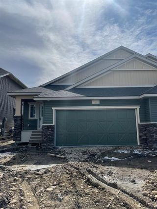 Main Photo: 1587 Ravensmoor Way SE: Airdrie Semi Detached for sale : MLS®# A1081235