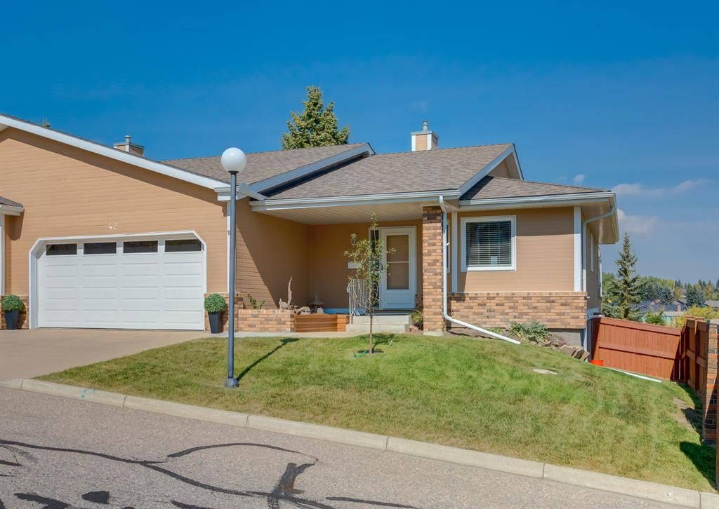 Main Photo: 42 140 Strathaven Circle SW in Calgary: Strathcona Park Semi Detached for sale : MLS®# A1146237