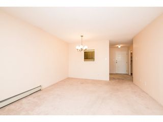 """Photo 7: 204 32098 GEORGE FERGUSON Way in Abbotsford: Abbotsford West Condo for sale in """"Heather Court"""" : MLS®# R2131436"""