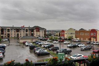 Photo 35: 1317 505 Railway Street W: Cochrane Apartment for sale : MLS®# A1111354