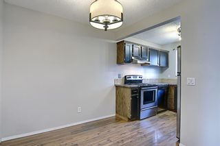 Photo 7: 161 7172 Coach Hill Road SW in Calgary: Coach Hill Row/Townhouse for sale : MLS®# A1101554